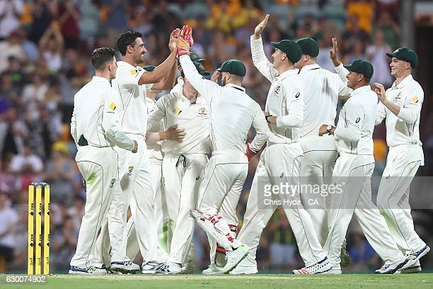 Mitchell Starc of Australia celebrates dismissing Yasir Shah of Pakistan during day two of the First Test match between Australia and Pakistan at The...