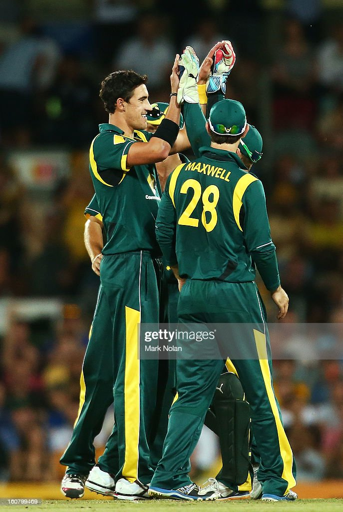 Mitchell Starc of Australia celebrates getting the wicket of Dwayne Bravo of the West Indies during the Commonwealth Bank One Day International Series between Australia and the West Indies at Manuka Oval on February 6, 2013 in Canberra, Australia.