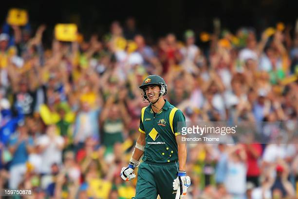 Mitchell Starc of Australia celebrates scoring his half century during game four of the Commonwealth Bank one day international series between...