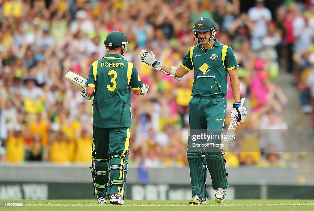 Mitchell Starc of Australia celebrates scoring his half century with team mate Xavier Doherty during game four of the Commonwealth Bank one day international series between Australia and Sri Lanka at Sydney Cricket Ground on January 20, 2013 in Sydney, Australia.