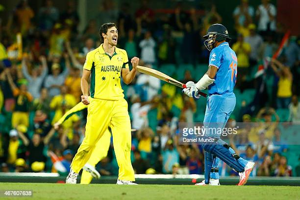 Mitchell Starc of Australia celebrates taking the final wicket during the 2015 Cricket World Cup Semi Final match between Australia and India at...