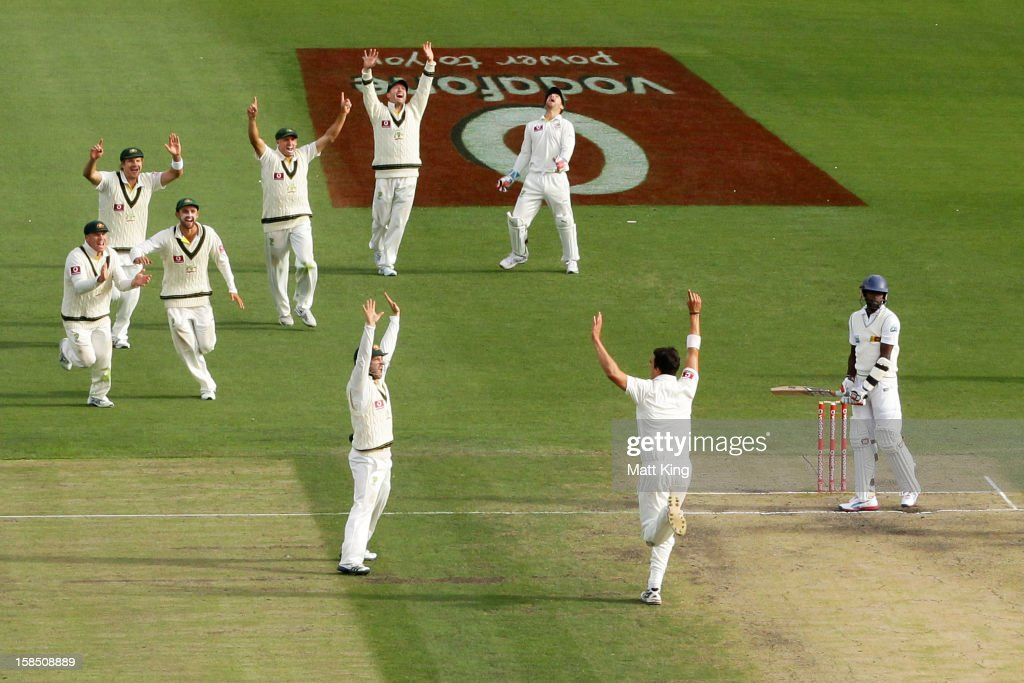<a gi-track='captionPersonalityLinkClicked' href=/galleries/search?phrase=Mitchell+Starc&family=editorial&specificpeople=6475541 ng-click='$event.stopPropagation()'>Mitchell Starc</a> of Australia celebrates taking the final wicket of Shaminda Eranga of Sri Lanka during day five of the First Test match between Australia and Sri Lanka at Blundstone Arena on December 18, 2012 in Hobart, Australia.