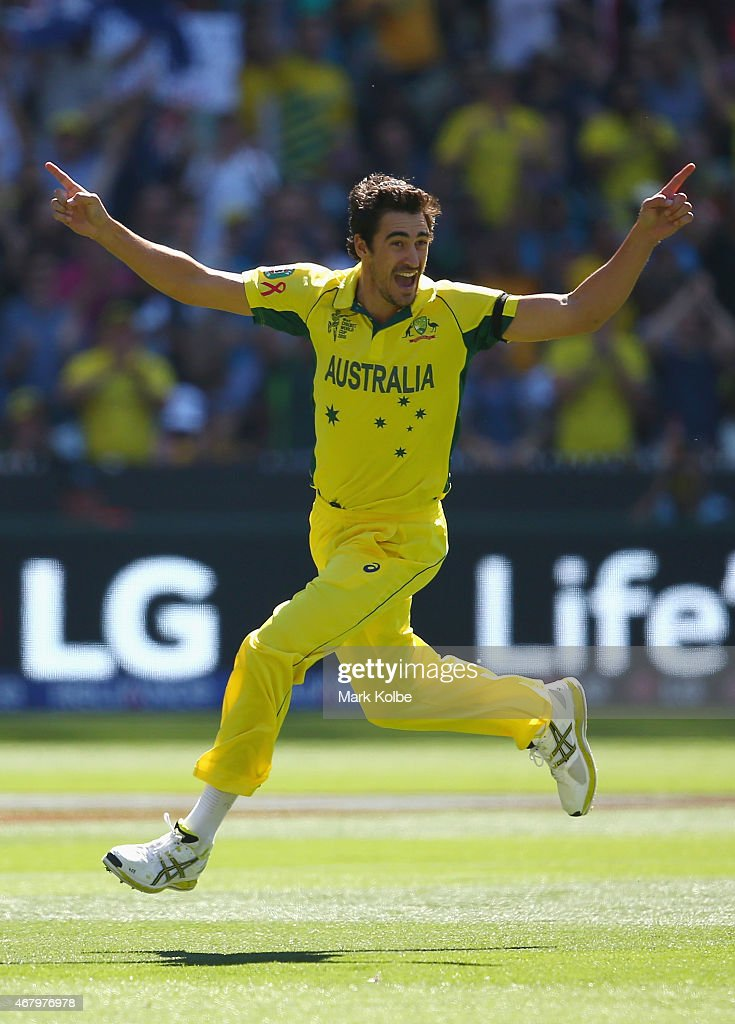 Mitchell Starc of Australia celebrates taking the wicket of Brendon McCullum of New Zealand during the 2015 ICC Cricket World Cup final match between...