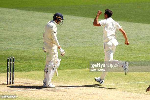 Mitchell Starc of Australia celebrates taking the wicket of Craig Overton of England during day five of the Second Test match during the 2017/18...