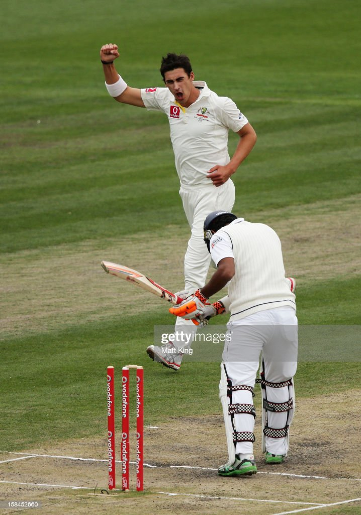 <a gi-track='captionPersonalityLinkClicked' href=/galleries/search?phrase=Mitchell+Starc&family=editorial&specificpeople=6475541 ng-click='$event.stopPropagation()'>Mitchell Starc</a> of Australia celebrates taking the wicket of Dimuth Karunaratne of Sri Lanka during day four of the First Test match between Australia and Sri Lanka at Blundstone Arena on December 17, 2012 in Hobart, Australia.