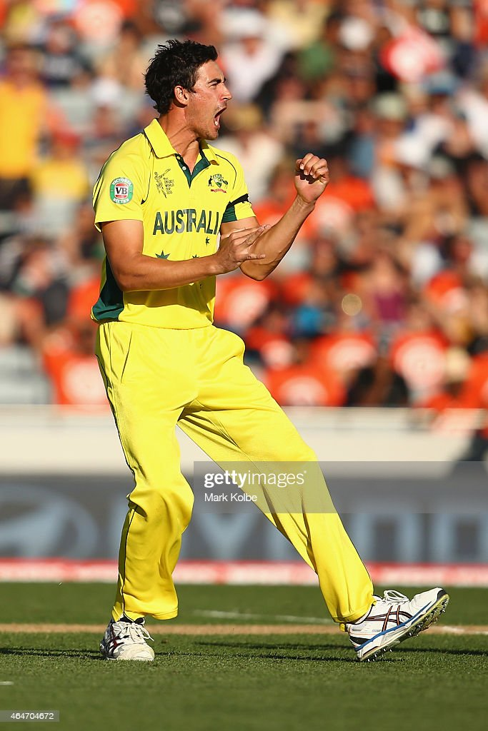 Mitchell Starc of Australia celebrates taking the wicket of Grant Elliott of New Zealand during the 2015 ICC Cricket World Cup match between...
