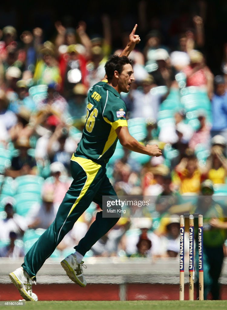 Mitchell Starc of Australia celebrates taking the wicket of Ian Bell of England with the first ball of the match during the One Day International...