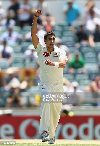 Mitchell Starc of Australia celebrates taking the wicket of Jacques Kallis of South Africa during day three of the Third Test Match between Australia...