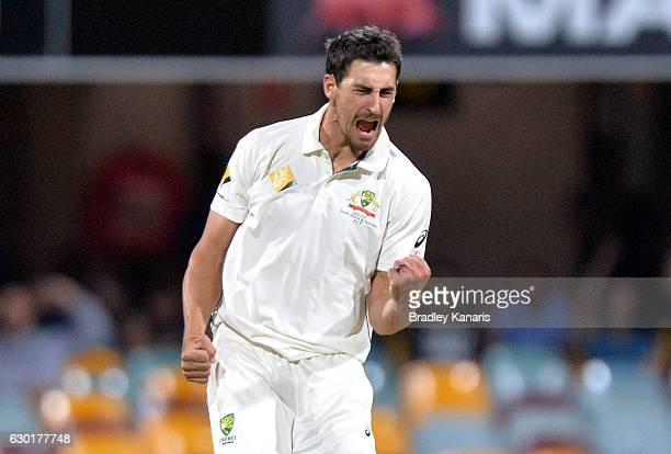 Mitchell Starc of Australia celebrates taking the wicket of Sarfraz Ahmed of Pakistan during day four of the First Test match between Australia and...