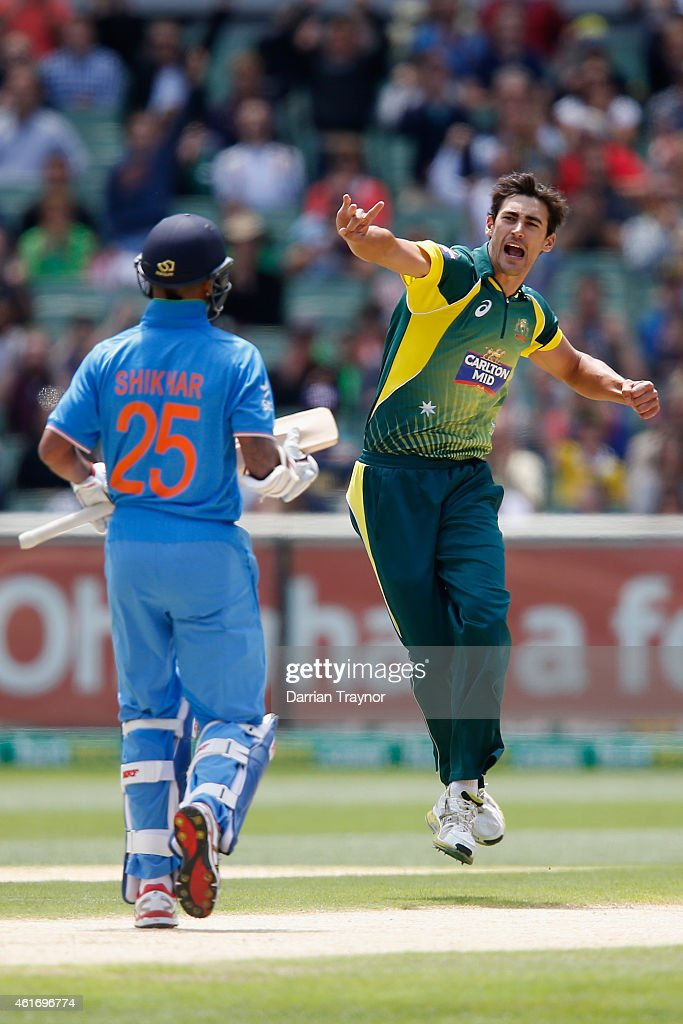 Mitchell Starc of Australia celebrates taking the wickey of Shikhar Dhawan of India during the One Day International match between Australia and...