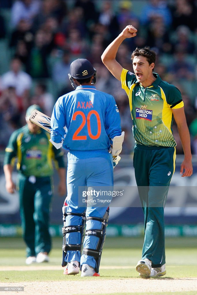 Mitchell Starc of Australia celebrates the wicket of Axar Patel of India during the One Day International match between Australia and India at...