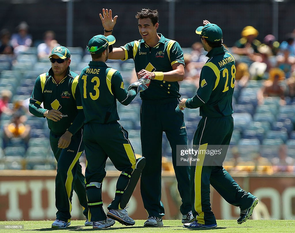 Mitchell Starc of Australia celebrates the wicket of Jason Holder of the West Indies during game one of the Commonwealth Bank One Day International Series between Australia and the West Indies at WACA on February 1, 2013 in Perth, Australia.