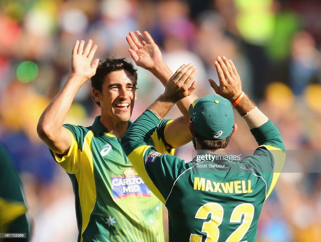 Mitchell Starc of Australia celebrates with Glenn Maxwell after dismissing Rohit Sharma of India during the One Day International match between...