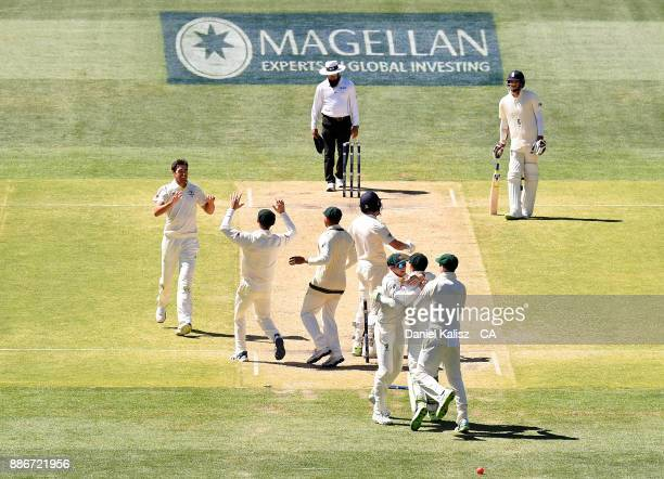 Mitchell Starc of Australia celebrates with his team mates after bowling out Jonny Bairstow of England to win the match for Australia during day five...