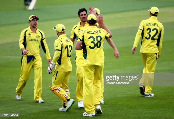 Mitchell Starc of Australia celebrates with his teammates after dismissing Tamim Iqbal of Bangladesh during the ICC Champions Trophy match between...