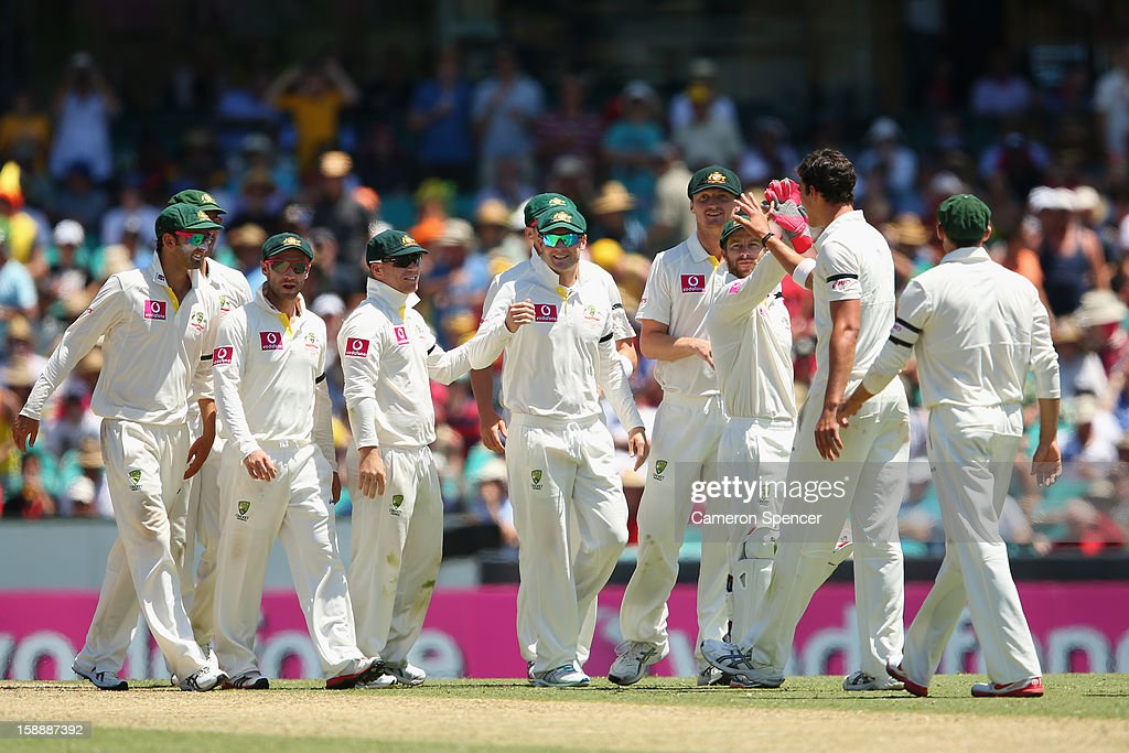 Mitchell Starc of Australia celebrates with team mates after dismissing Mahela Jayawardene of Sri Lanka during day one of the Third Test match between Australia and Sri Lanka at the Sydney Cricket Ground on January 3, 2013 in Sydney, Australia.
