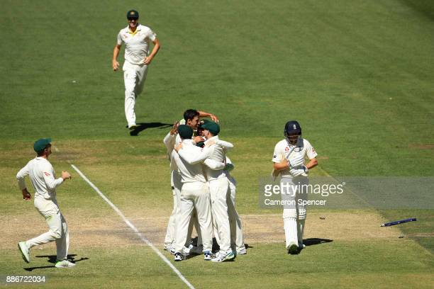 Mitchell Starc of Australia celebrates with team mates after taking the final wicket of Jonny Bairstow of England and winning the test during day...