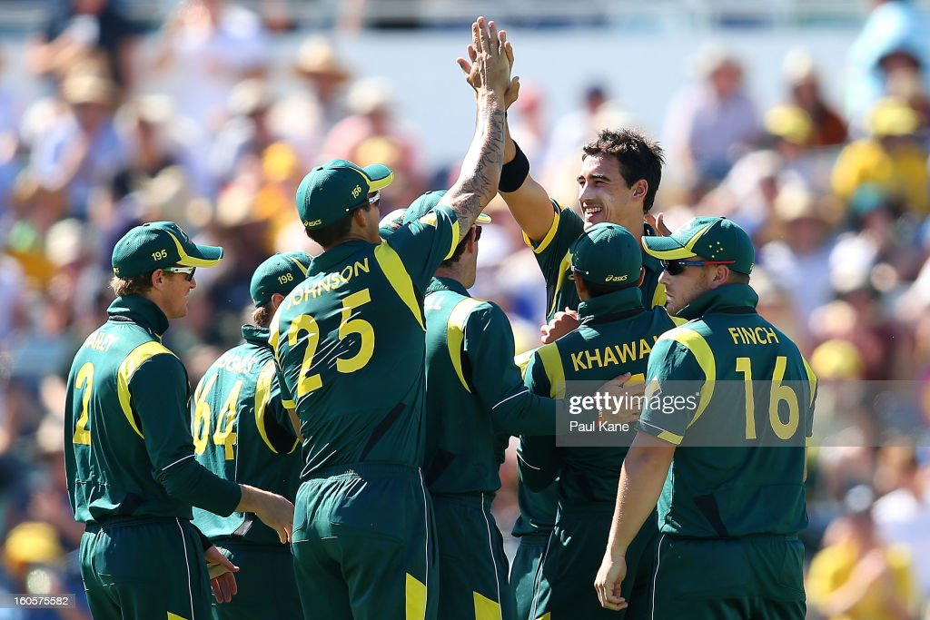 Mitchell Starc of Australia celebrates with team mates the wicket of Chris Gayle of the West Indies during game two of the Commonwealth Bank One Day International Series between Australia and the West Indies at WACA on February 3, 2013 in Perth, Australia.
