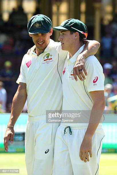 Mitchell Starc of Australia embraces team mate Matt Renshaw after winnning the test during day five of the Third Test match between Australia and...