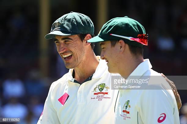 Mitchell Starc of Australia embraces team mate Matt Renshaw after winnning the test during day five of the Third Test match between Australia and...