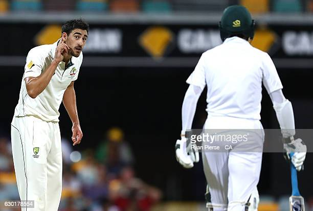 Mitchell Starc of Australia has words with Mohammad Amir of Pakistan during day four of the First Test match between Australia and Pakistan at The...