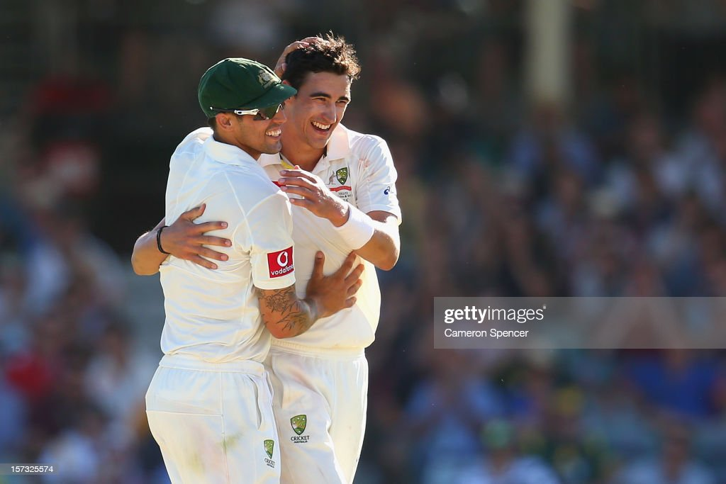 <a gi-track='captionPersonalityLinkClicked' href=/galleries/search?phrase=Mitchell+Starc&family=editorial&specificpeople=6475541 ng-click='$event.stopPropagation()'>Mitchell Starc</a> of Australia (R) is congratulated by team mate Mitchell Johnson after dismissing Morne Morkel of South Africa during day three of the Third Test Match between Australia and South Africa at the WACA on December 2, 2012 in Perth, Australia.