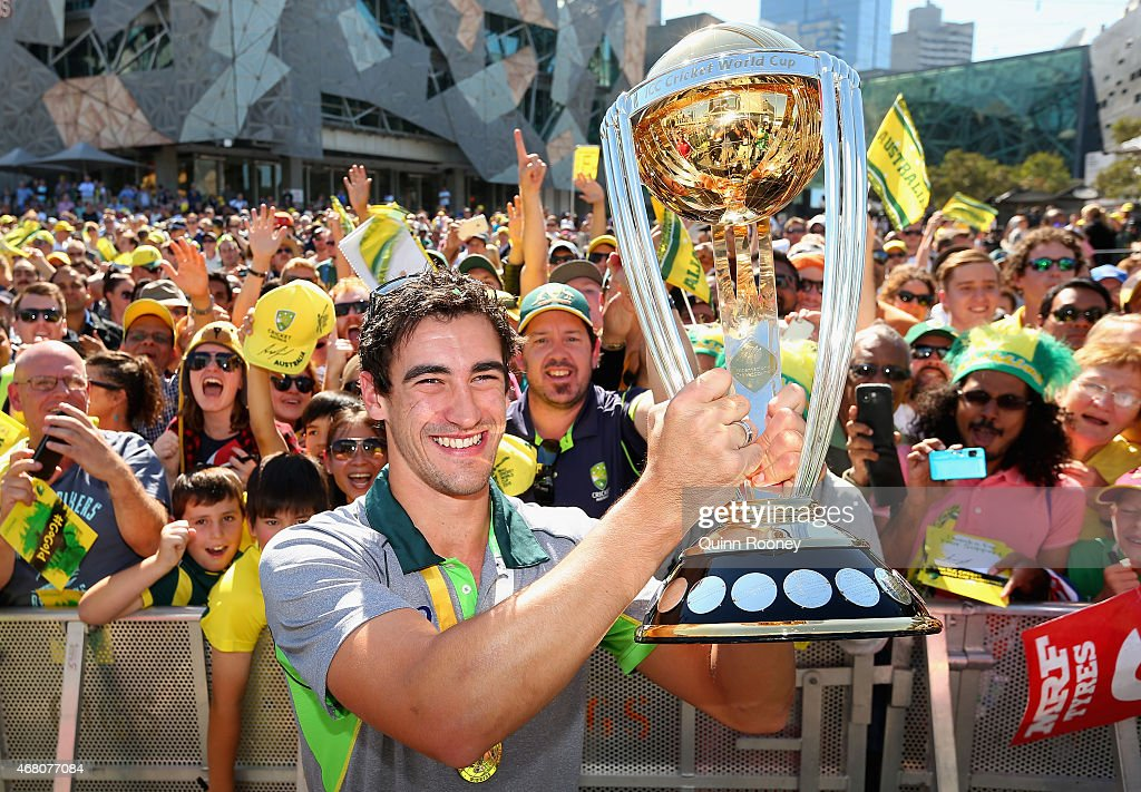 Mitchell Starc of Australia poses with the trophy during celebrations after winning the 2015 ICC Cricket World Cup Final at Federation Square on...