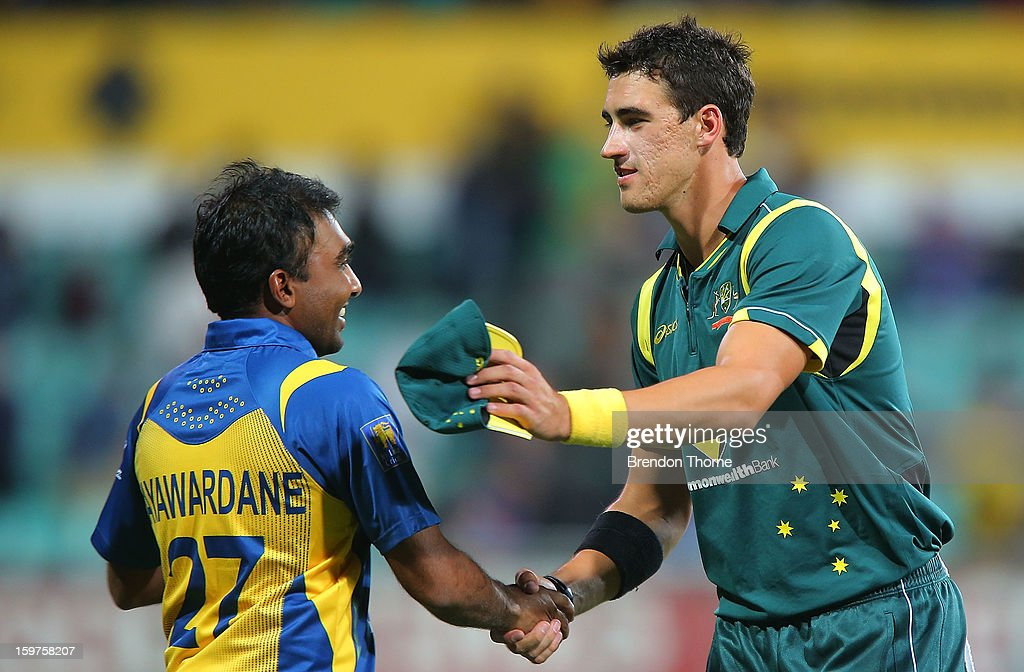 Mitchell Starc of Australia shakes hands with Mahela Jayawardena of Sri Lanka after play was abandoned due to rain following game four of the Commonwealth Bank one day international series between Australia and Sri Lanka at Sydney Cricket Ground on January 20, 2013 in Sydney, Australia.