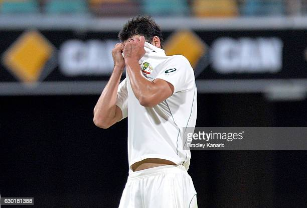 Mitchell Starc of Australia shows his disappointment after team mate Steve Smith drops a catch in the slips during day four of the First Test match...