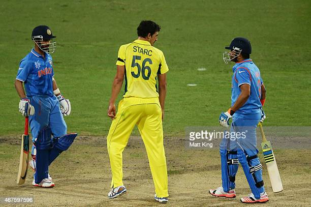 Mitchell Starc of Australia speaks to MS Dhoni of India during the 2015 Cricket World Cup Semi Final match between Australia and India at Sydney...