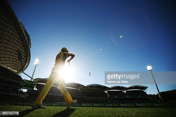 Mitchell Starc of Australia stands on the boundary during game five of the One Day International series between Australia and Pakistan at Adelaide...