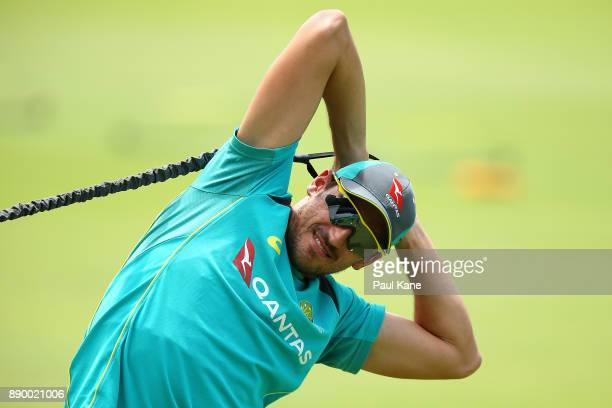 Mitchell Starc of Australia stretches during an Australian nets session at WACA on December 11 2017 in Perth Australia