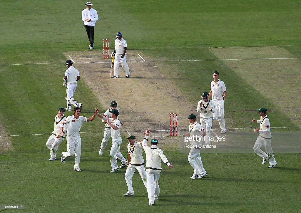 <a gi-track='captionPersonalityLinkClicked' href=/galleries/search?phrase=Mitchell+Starc&family=editorial&specificpeople=6475541 ng-click='$event.stopPropagation()'>Mitchell Starc</a> of Australia takes the wicket of Nuwan Kulasekara of Sri Lanka during day five of the First Test match between Australia and Sri Lanka at Blundstone Arena on December 18, 2012 in Hobart, Australia.