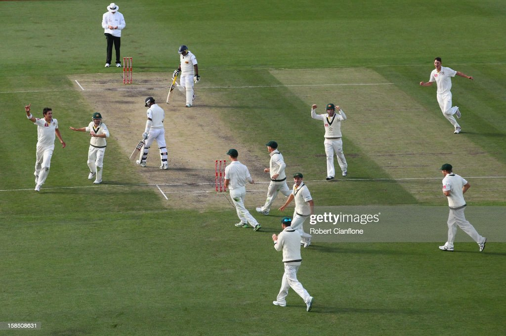 Mitchell Starc of Australia takes the wicket of Nuwan Kulasekara of Sri Lanka during day five of the First Test match between Australia and Sri Lanka at Blundstone Arena on December 18, 2012 in Hobart, Australia.