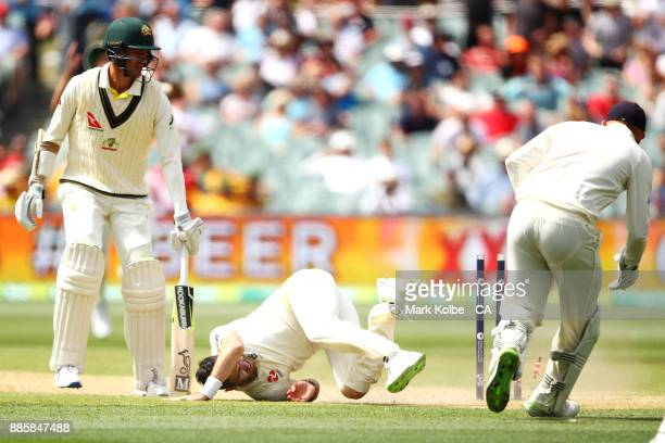 Mitchell Starc of Australia watches on as James Anderson of England falls after dropping a catch during day four of the Second Test match during the...