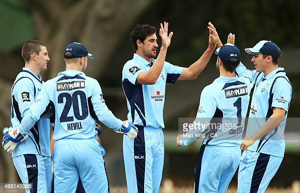 Mitchell Starc of the Blues celebrates with team mates after taking the wicket of Aaron Finch of the Bushrangers during the Matador BBQs One Day Cup...