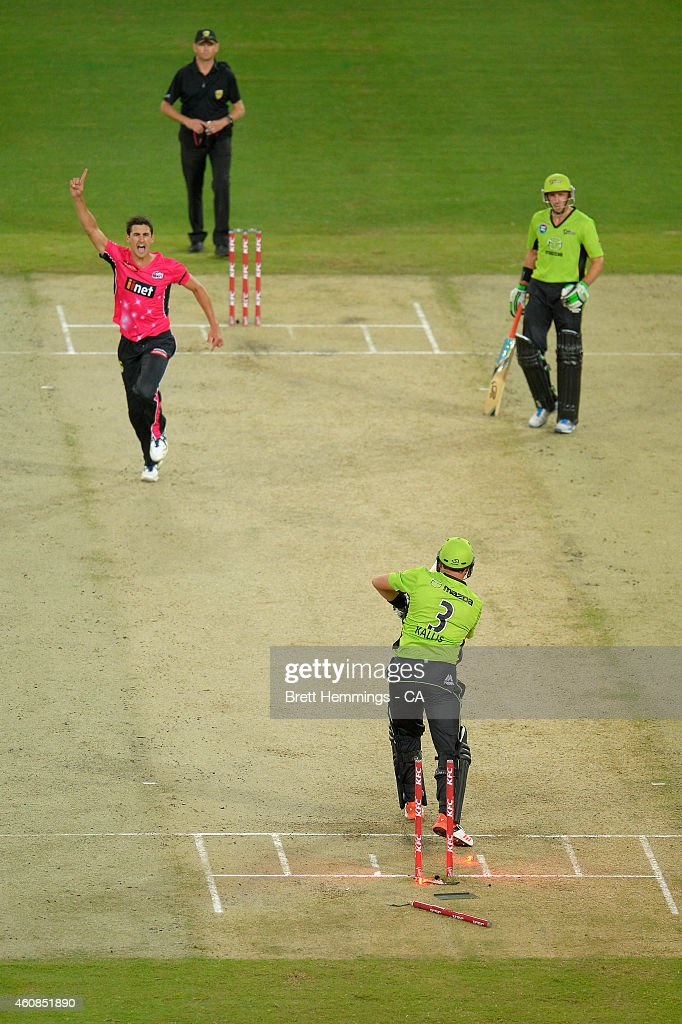 Mitchell Starc of the Sixers celebrates after taking the wicket of Jacques Kallis of the Thunder during the Big Bash League match between the Sydney...