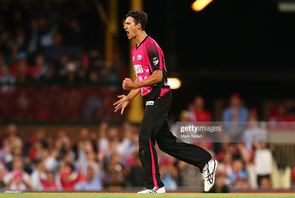 Mitchell Starc of the Sixers celebrates bowling Adam Voges of Perth during the Big Bash League semi final match between the Sydney Sixers and the...