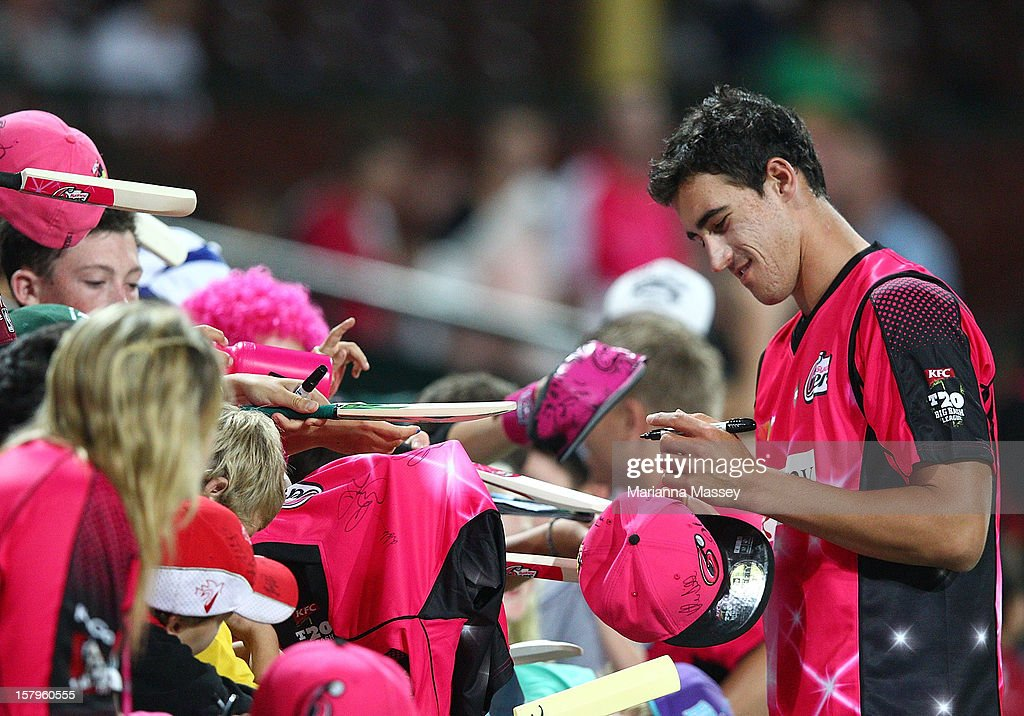 <a gi-track='captionPersonalityLinkClicked' href=/galleries/search?phrase=Mitchell+Starc&family=editorial&specificpeople=6475541 ng-click='$event.stopPropagation()'>Mitchell Starc</a> of the Sixers signs autographs for fans after the Big Bash League match between the Sydney Sixers and the Sydney Thunder at Sydney Cricket Ground on December 8, 2012 in Sydney, Australia.