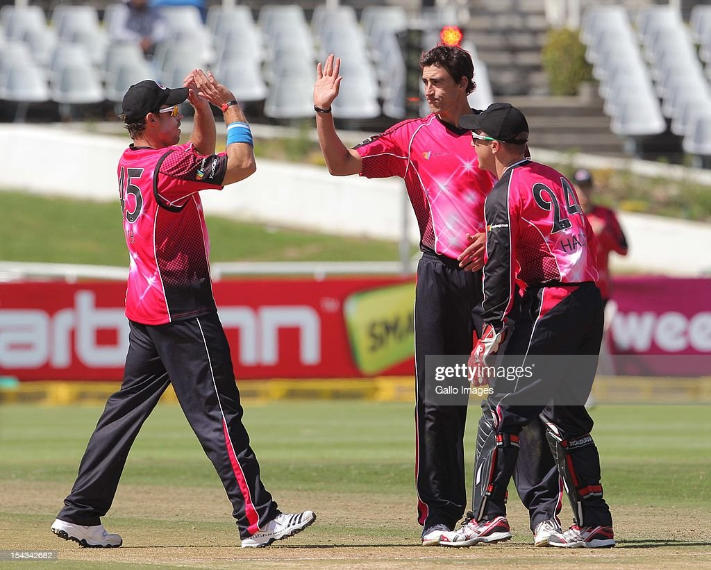 <a gi-track='captionPersonalityLinkClicked' href=/galleries/search?phrase=Mitchell+Starc&family=editorial&specificpeople=6475541 ng-click='$event.stopPropagation()'>Mitchell Starc</a> of the Sydney Sixers celebrates the wicket of Gulam Bodi of the Highveld Lions during the Karbonn Smart CLT20 match between bizbub Highveld Lions (South Africa) and Sydney Sixers (Australia) at Sahara Park Newlands on October 18, 2012 in Cape Town, South Africa.
