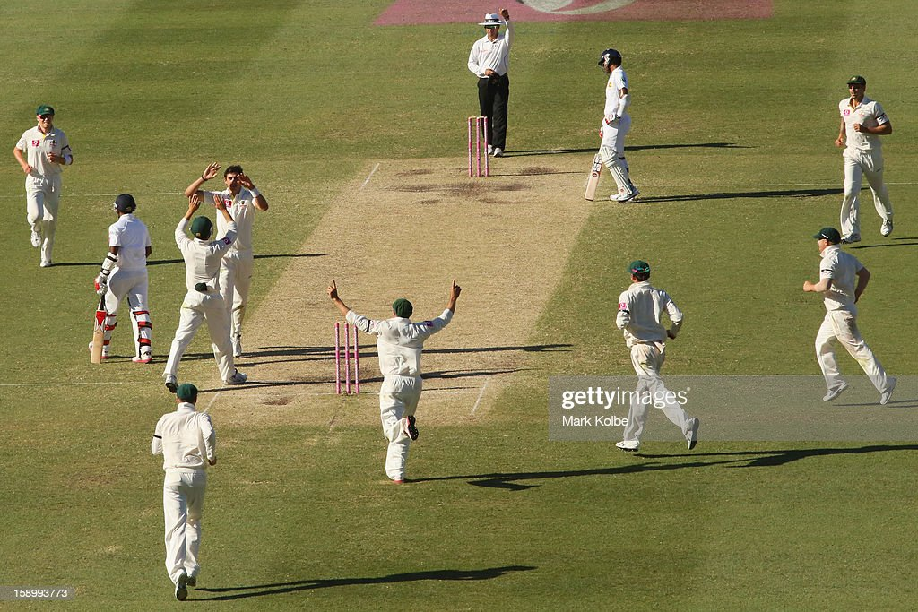Mitchell Stark of Australia celebrates with is team mates after taking the wicket of Dhammika Prasad of Sri Lanka during day three of the Third Test match between Australia and Sri Lanka at Sydney Cricket Ground on January 5, 2013 in Sydney, Australia.