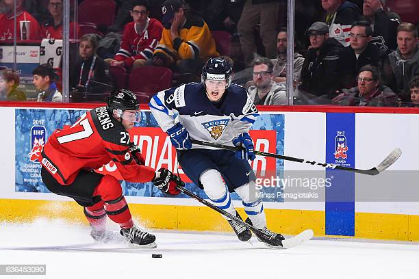 Mitchell Stephens of Team Canada challenges Janne Kuokkanen of Team Finland during the IIHF exhibition game at the Bell Centre on December 19 2016 in...