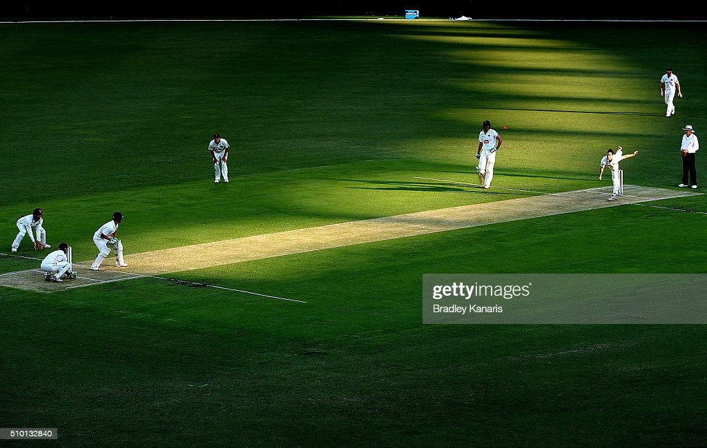 Mitchell Swepson of Queensland bowls to Ben McDermott of Tasmania during day one of the Sheffield Shield match between Queensland and Tasmania at The Gabba on February 14, 2016 in Brisbane, Australia.