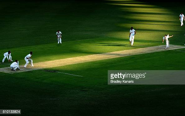 Mitchell Swepson of Queensland bowls to Ben McDermott of Tasmania during day one of the Sheffield Shield match between Queensland and Tasmania at The...