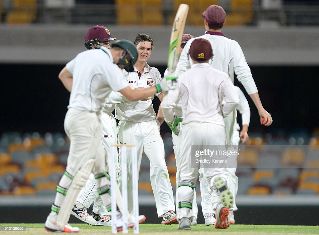 Mitchell Swepson of Queensland celebrates with his team mates after taking the wicket of Tom Triffitt of Tasmania during day one of the Sheffield Shield match between Queensland and Tasmania at The Gabba on February 14, 2016 in Brisbane, Australia.