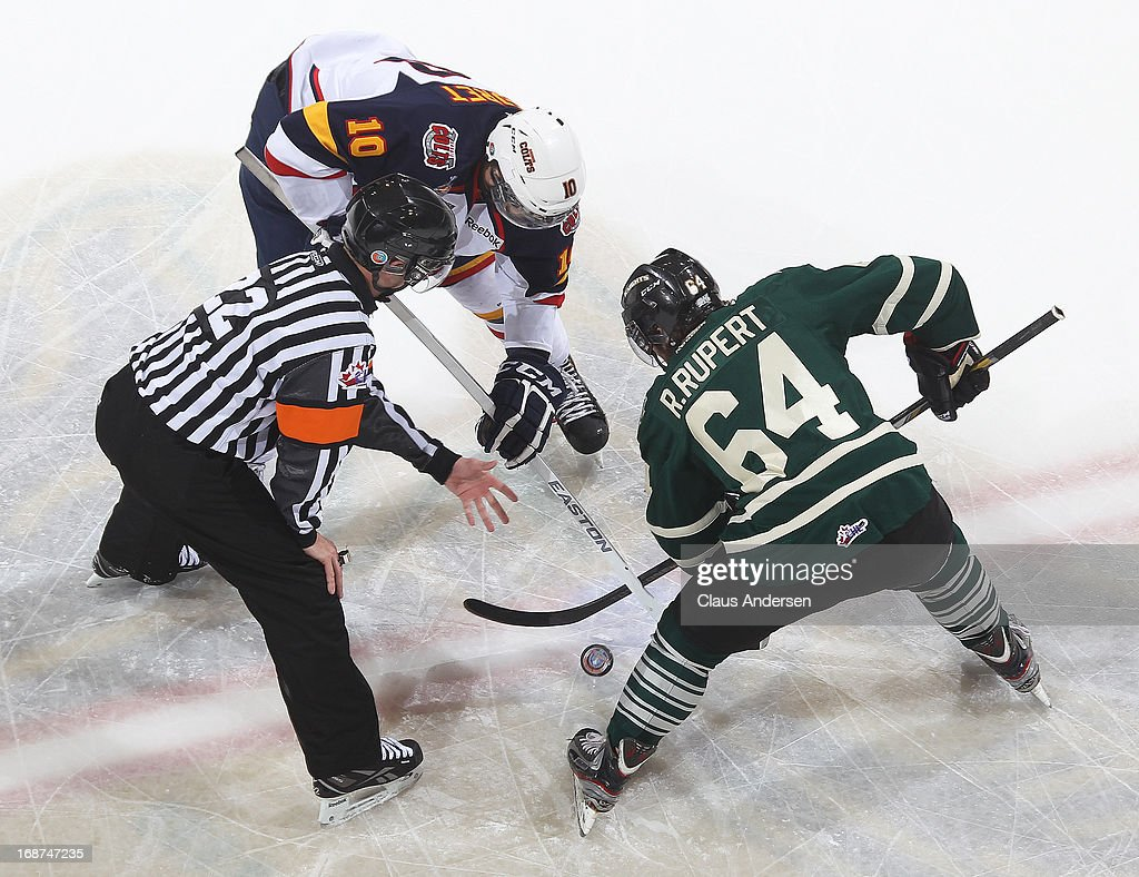 Mitchell Theoret #10 of the Barrie Colts takes a faceoff against Ryan Rupert #64 of the London Knights in Game Seven in the 2013 OHL Championship Final on May 13, 2013 at the Budweiser Gardens in London, Ontario, Canada. The Knights defeated the Colts 3-2.