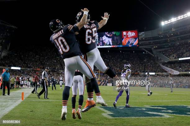 Mitchell Trubisky and Cody Whitehair of the Chicago Bears celebrate after scoring against the Minnesota Vikings in the fourth quarter at Soldier...