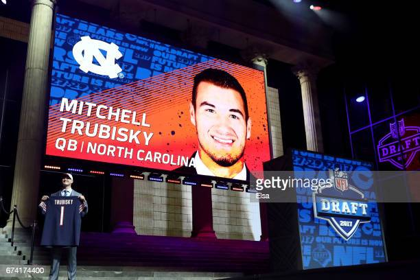 Mitchell Trubisky of North Carolina poses after being picked overall by the Chicago Bears during the first round of the 2017 NFL Draft at the...