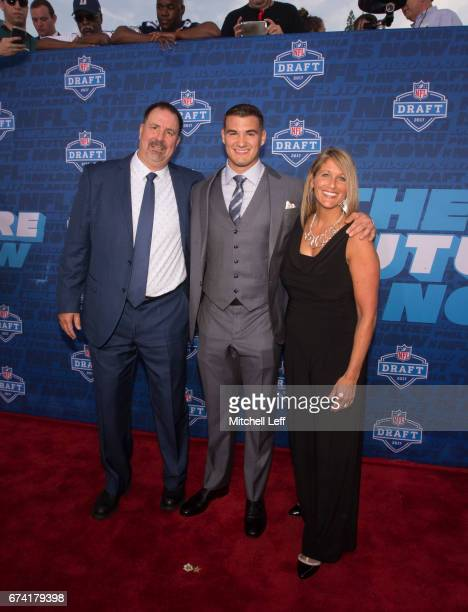 Mitchell Trubisky of North Carolina poses for a picture with his father David Trubisky and mother Jeanne Turbisky on the red carpet prior to the...