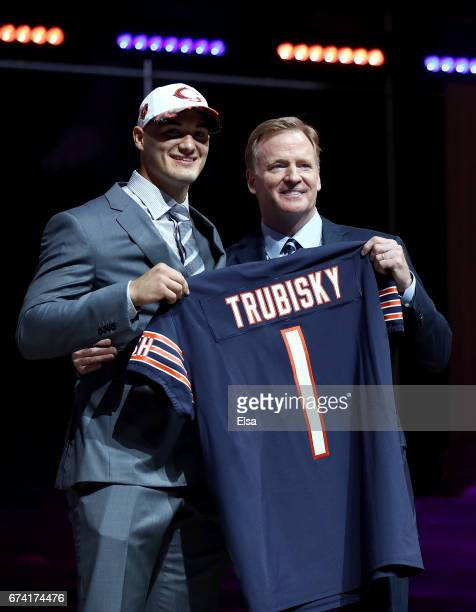Mitchell Trubisky of North Carolina poses with Commissioner of the National Football League Roger Goodell after being picked overall by the Chicago...